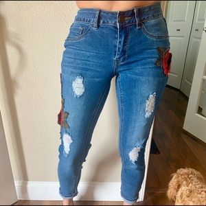 Distressed jeans with Rose detail